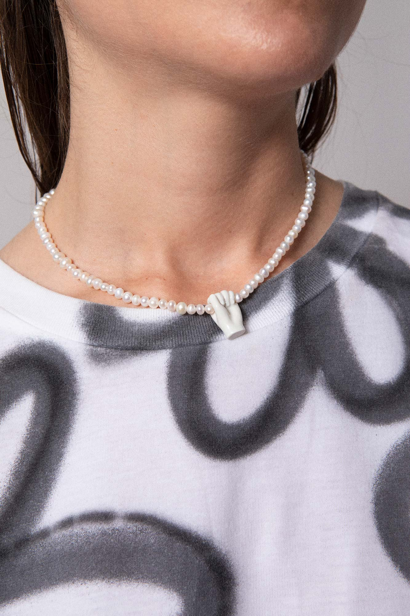 FIST & PEARLS NECKLACE